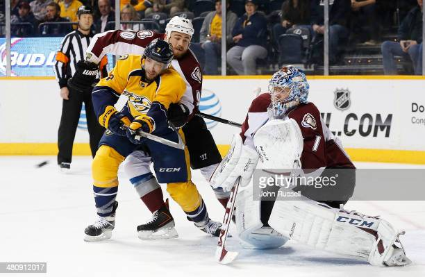 Matt Cullen of the Nashville Predators battles to tip a shot against Ryan O'Reilly and Semyon Varlamov of the Colorado Avalanche during an NHL game...