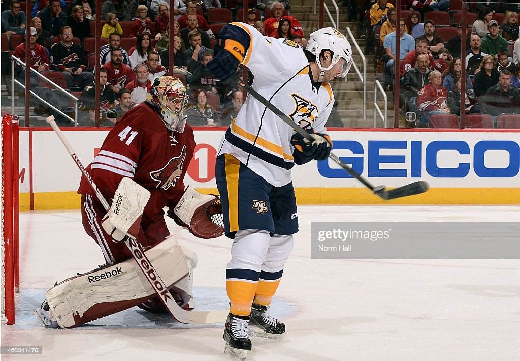 Matt Cullen #7 of the Nashville Predators tries to re-direct the puck past goaltender Mike Smith #41 of the Arizona Coyotes during the third period Gila River Arena on December 11, 2014 in Glendale, Arizona.