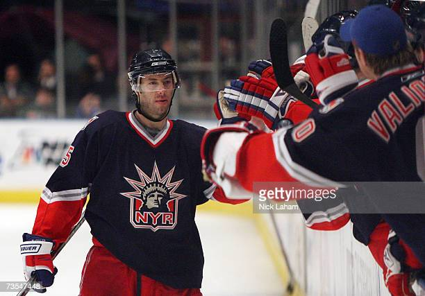 Matt Cullen of the New York Rangers celebrates his shoot out goal with teammates in the match against the Carolina Hurricanes on March 11 2007 at...