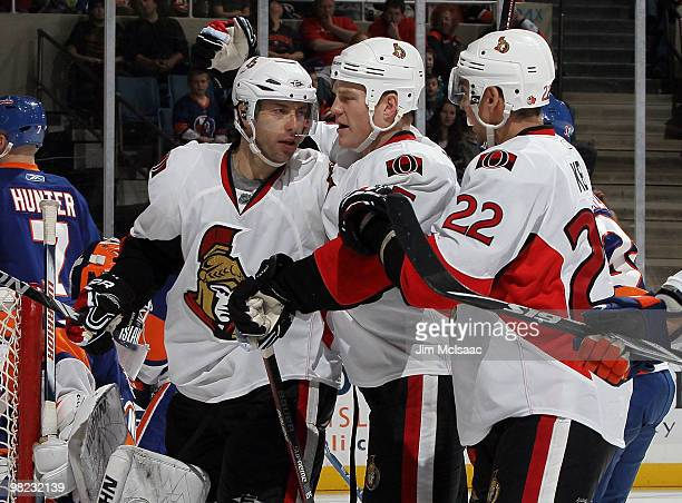 Matt Cullen of the Ottawa Senators celebrates his goal against the New York Islanders with teammates Chris Neil and Chris Kelly on April 3 2010 at...