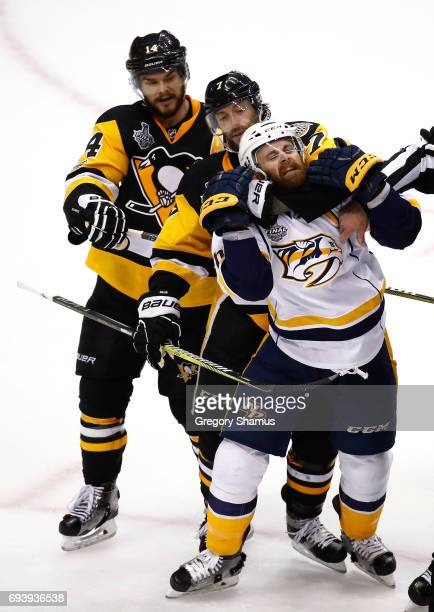 Matt Cullen of the Pittsburgh Penguins and Harry Zolnierczyk of the Nashville Predators get tangled in the third period in Game Five of the 2017 NHL...