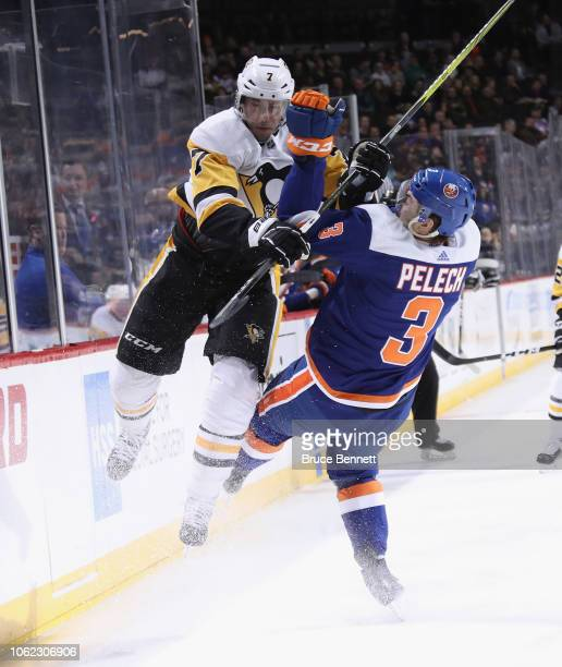 Matt Cullen of the Pittsburgh Penguins checks Adam Pelech of the New York Islanders during the first period at the Barclays Center on November 01...