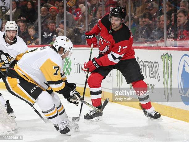 Matt Cullen of the Pittsburgh Penguins skates against Kenny Agostino of the New Jersey Devils during the third period at the Prudential Center on...