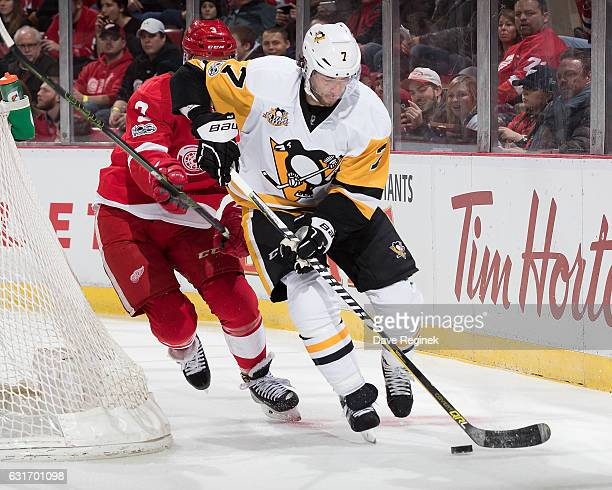 Matt Cullen of the Pittsburgh Penguins skates with the puck behind the net followed by Nick Jensen of the Detroit Red Wings during an NHL game at Joe...