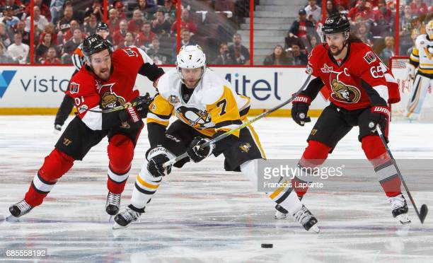 Matt Cullen of the Pittsburgh Penguins skates with the puck past Mark Stone and Erik Karlsson of the Ottawa Senators in Game Four of the Eastern...