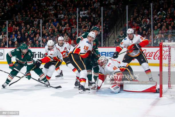 Matt Cullen scores a goal while his Minnesota Wild is defended by Mark Giordano Matthew Tkachuk Travis Hamonic and goalie Mike Smith of the Calgary...