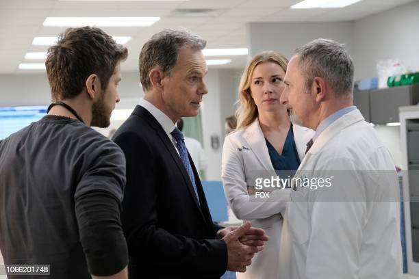 Matt Czuchry Bruce Greenwood Emily VanCamp and guest star Andy Milder in the 'Trial Error' episode of THE RESIDENT airing Monday Nov 5 on FOX