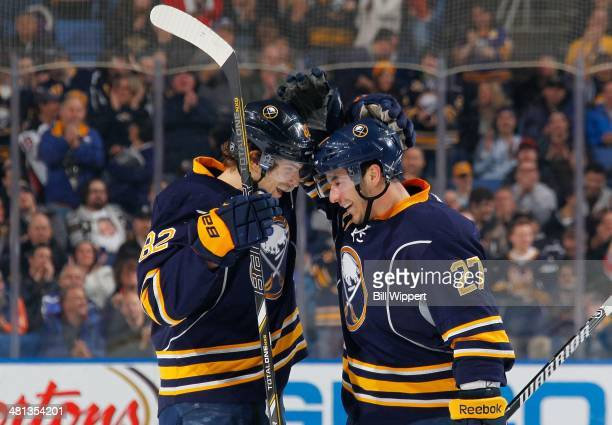Matt D'Agostini of the Buffalo Sabres celebrates his first period goal against the Tampa Bay Lightning with teammate Marcus Foligno on March 29 2014...
