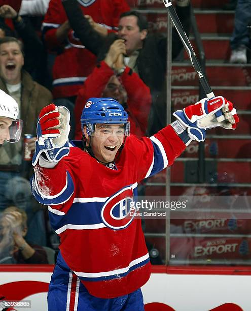Matt D'Agostini of the Montreal Canadiens celebrates his first period goal against the New Jersey Devils during their NHL game at the Bell Centre...
