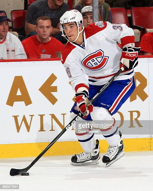 Matt D'agostini of the Montreal Canadiens skates up ice with the puck during NHL preseason opener against the Detroit Red Wings on September 24 2008...