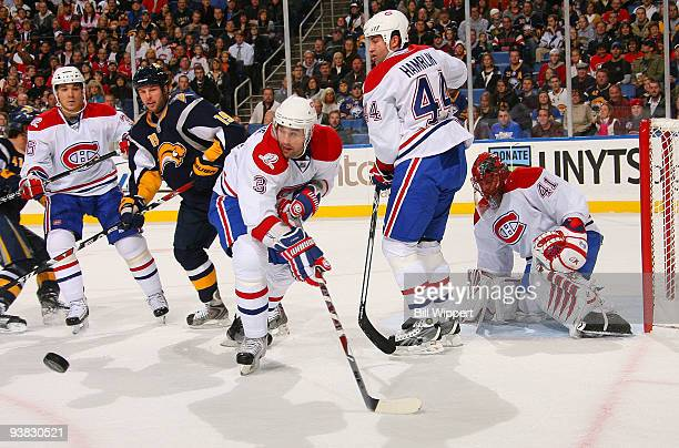 Matt D'Agostini Ryan O'Byrne Roman Hamrlik and Jaroslav Halak of the Montreal Canadiens keep a close eye on the puck while defending Tim Connolly of...