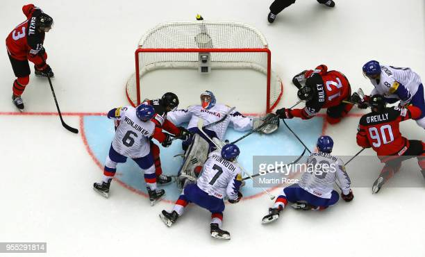Matt Dalton goaltender of Korea tends net against Joshua Bailey of Canada during the 2018 IIHF Ice Hockey World Championship group stage game between...