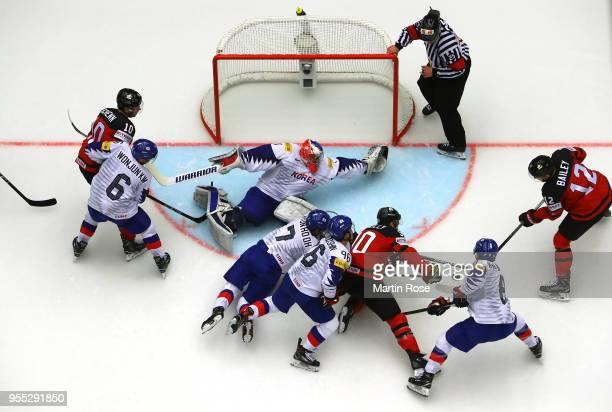 Matt Dalton goaltender of Korea tends net against Joshua Bailey of Canada during the 2018 IIHF Ice Hockey World Championship group stage game between...