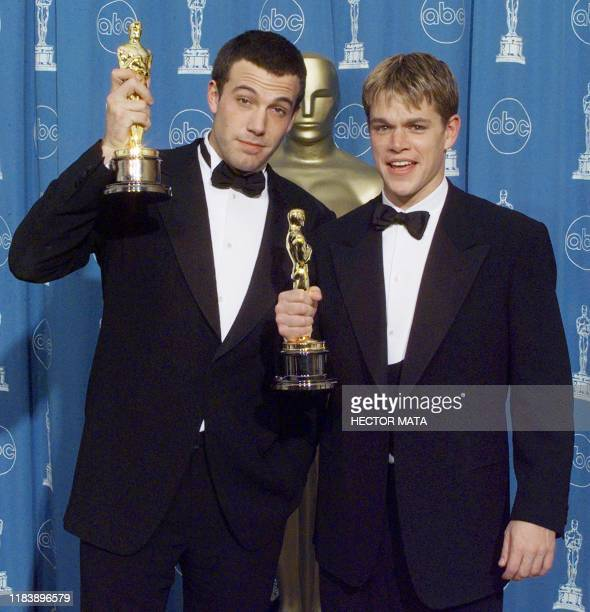 """Matt Damon and Ben Affleck pose with their Oscars they won for Best Original Screenplay for """"Good Will Hunting"""" 23 March at the 70th Annual Academy..."""