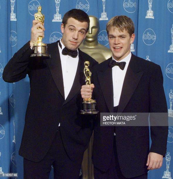 "Matt Damon and Ben Affleck pose with their Oscars they won for Best Original Screenplay for ""Good Will Hunting"" 23 March at the 70th Annual Academy..."