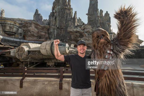 Matt Damon encounters Chewbacca at the new Star Wars: Galaxys Edge August 5, 2019 at Disneyland Park in Anaheim, California. Damon, who was...