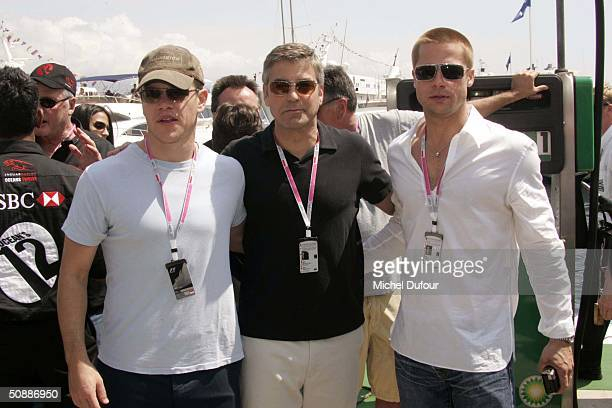 Matt Damon, George Clooney and Brad Pitt take a guided tour of the Jaguar garage as the official guests of Jaguar Racing during a photo-call to...