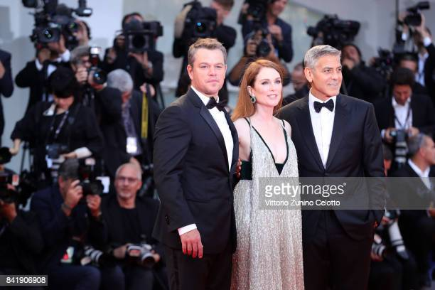 Matt Damon Julianne Moore and George Clooney walk the red carpet ahead of the 'Suburbicon' screening during the 74th Venice Film Festival at Sala...