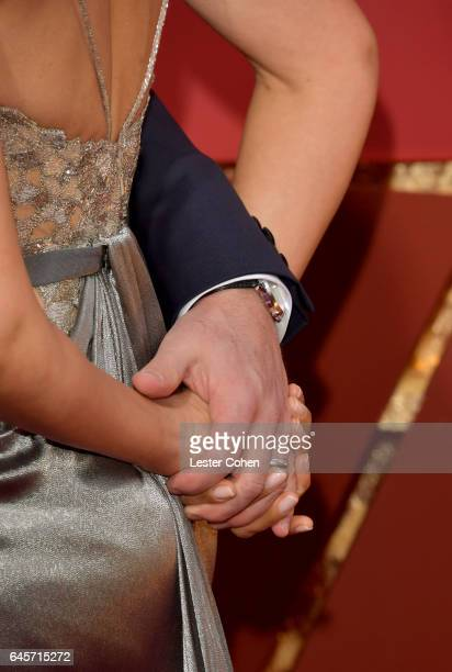 Matt Damon tries to hold the hand of Luciana Damon as they attend the 89th Annual Academy Awards at Hollywood Highland Center on February 26 2017 in...