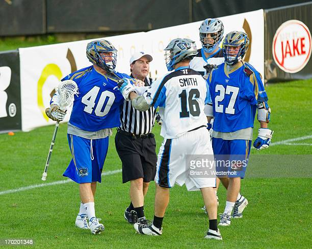 Matt Danowski of the Charlotte Hounds and Joe Smith of the Ohio Machine have to be seperated during second quarter action at American Legion Memorial...