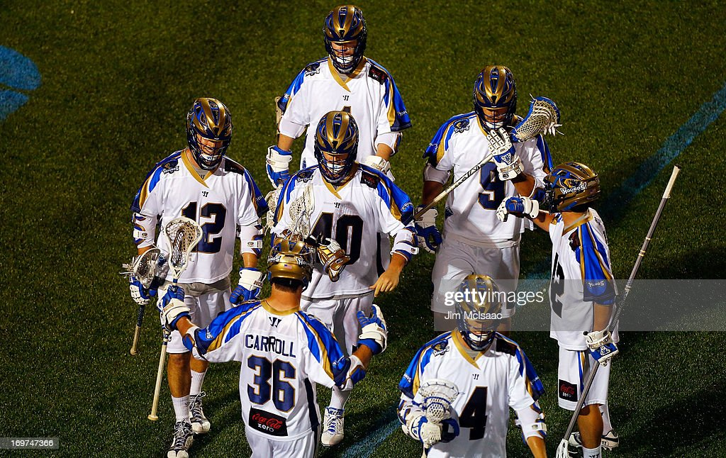 Matt Danowski #40 of the Charlotte Hounds celebrates a goal against the New York Lizards with his teammates during their Major League Lacrosse game at Shuart Stadium on May 31, 2013 in Uniondale, New York. The Hounds defeated the Lizards 14-12.