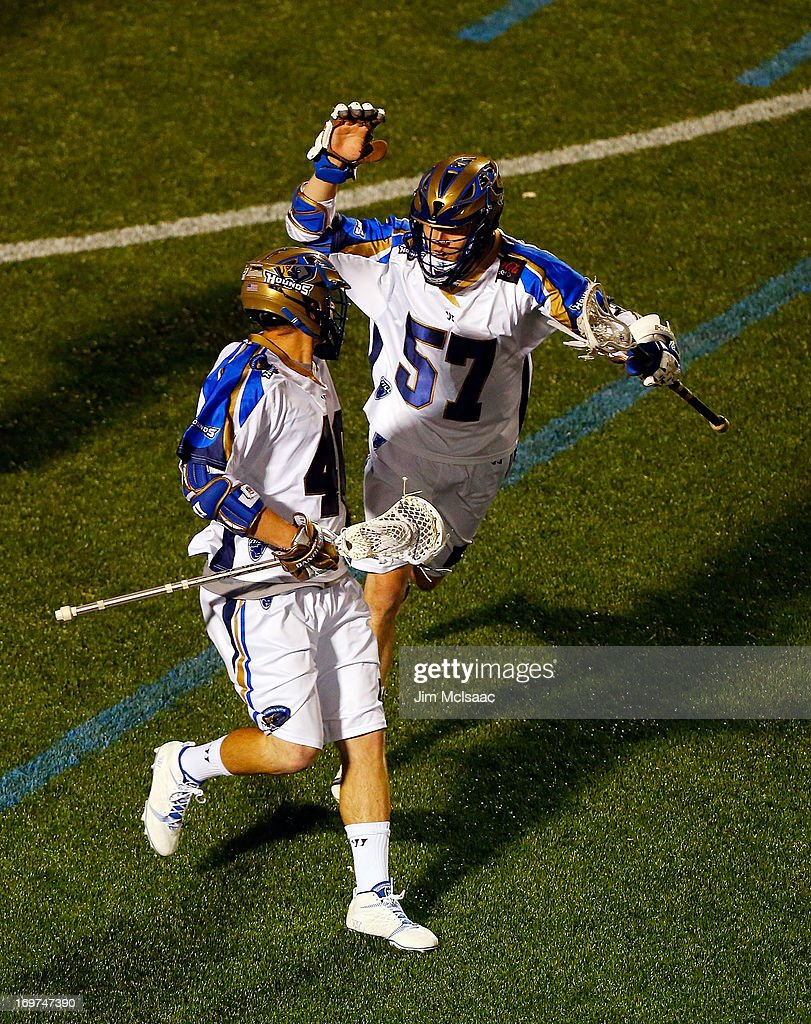 Matt Danowski #40 of the Charlotte Hounds celebrates his second goal against the New York Lizards with teammate Peet Poillon #57 during their Major League Lacrosse game at Shuart Stadium on May 31, 2013 in Uniondale, New York.