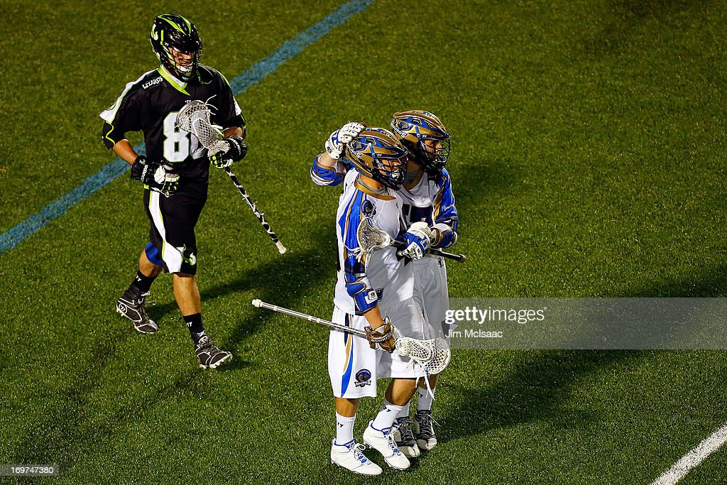 Matt Danowski #40 of the Charlotte Hounds celebrates his second goal with teammate Peet Poillon #57 as Kevin Unterstein #86 of the New York Lizards looks onb during their Major League Lacrosse game at Shuart Stadium on May 31, 2013 in Uniondale, New York.