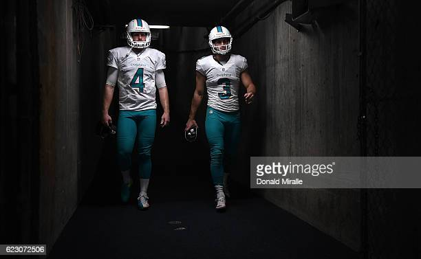 Matt Darr and Andrew Franks of the Miami Dolphins prepare to enter the field for a game against the San Diego Chargers Game at Qualcomm Stadium on...