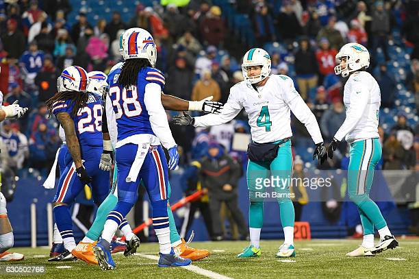 Matt Darr of the Miami Dolphins celebrates after Andrew Franks kicked the game winning field goal in overtime against the Buffalo Bills at New Era...
