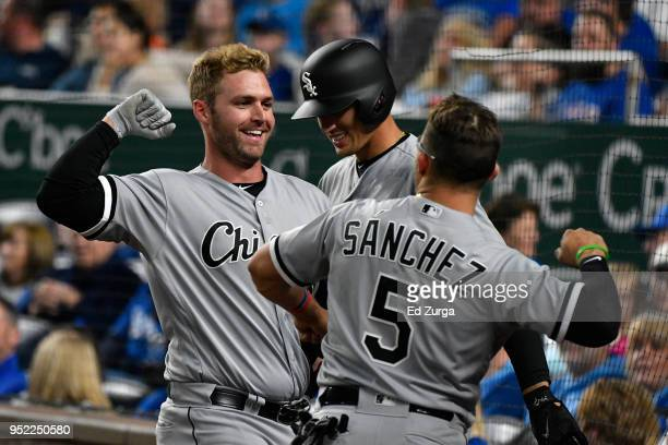 Matt Davidson of the Chicago White Sox celebrates his home run with Yolmer Sanchez of the Chicago White Sox in the fourth inning against the Kansas...