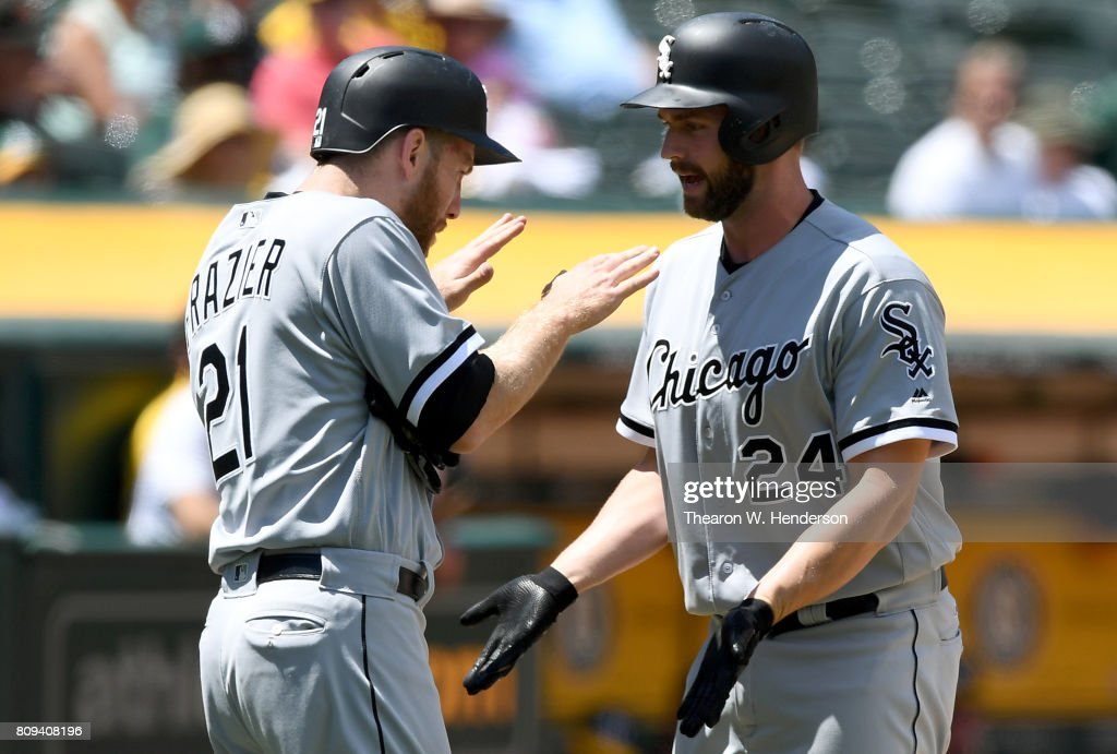 Matt Davidson #24 of the Chicago White Sox is congratulated by Todd Frazier #21 after Davidson hit a two-run homer against the Oakland Athletics in the top of the fifth inning at Oakland Alameda Coliseum on July 5, 2017 in Oakland, California.