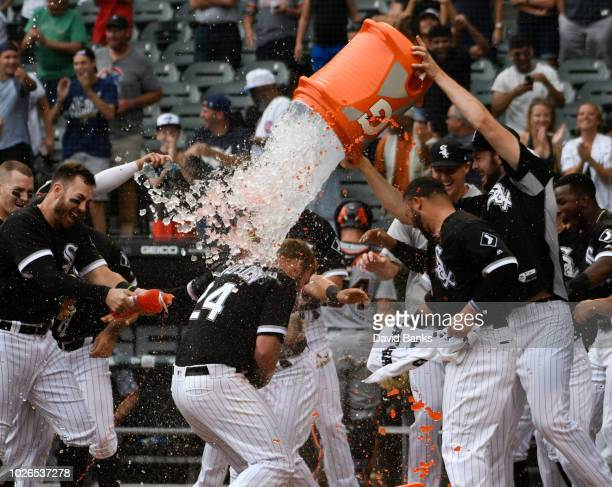 Matt Davidson of the Chicago White Soxis greeted by his teammates after hitting a tworun walkoff home run against the Detroit Tigers during the ninth...