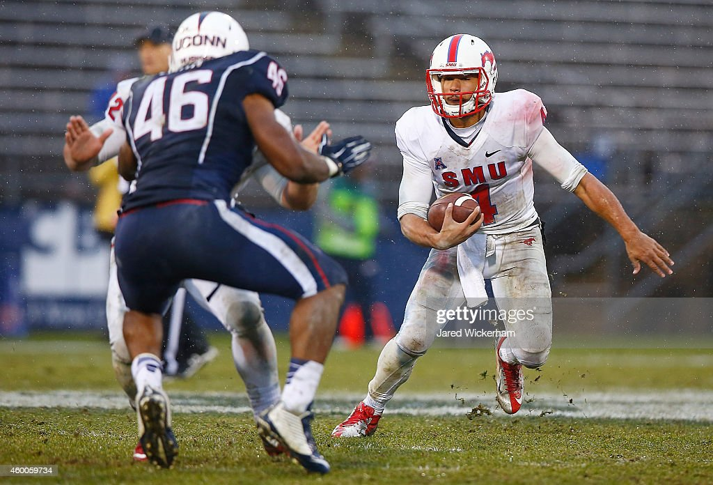 Matt Davis #4 of the SMU Mustangs runs with the ball in the fourth quarter against the Connecticut Huskies during the game at Rentschler Field on December 6, 2014 in East Hartford, Connecticut.