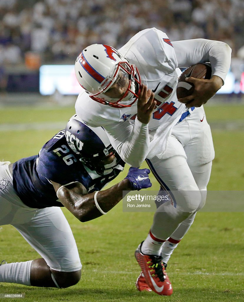 Matt Davis #4 of the Southern Methodist Mustangs is hit by Derrick Kindred #26 of the TCU Horned Frogs before crossing the goal line to score a touchdown in the third quarter at Amon G. Carter Stadium on September 19, 2015 in Fort Worth, Texas.