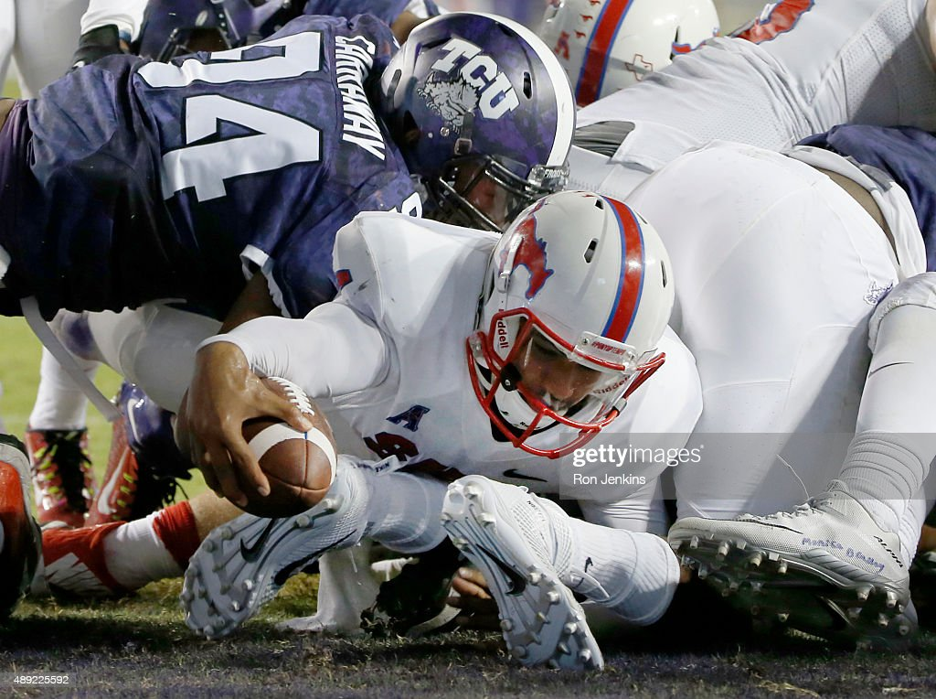 Matt Davis #4 of the Southern Methodist Mustangs reaches across the goal line to score a touchdown against the TCU Horned Frogs in the third quarter at Amon G. Carter Stadium on September 19, 2015 in Fort Worth, Texas.