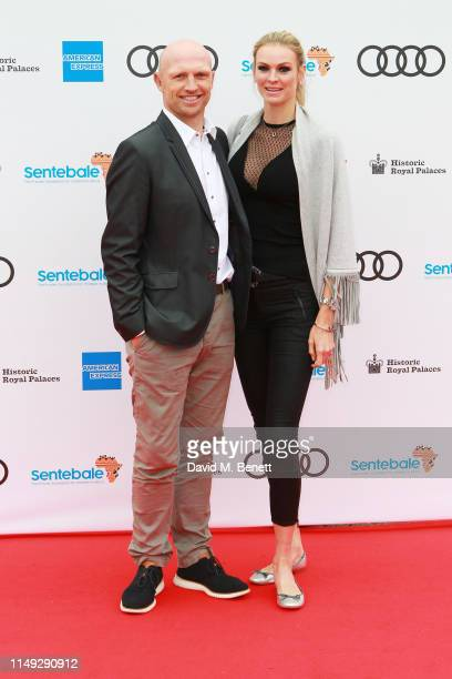 Matt Dawson and Carolin Hauskeller arrive at the Audi Sentebale Concert at Hampton Court Palace on June 11 2019 in London England