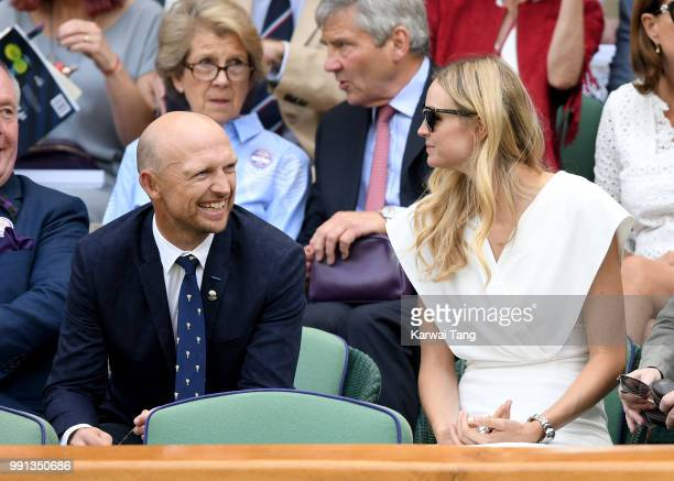 Matt Dawson and wife Carolin Hauskeller sit in the royal box on day three of the Wimbledon Tennis Championships at the All England Lawn Tennis and...