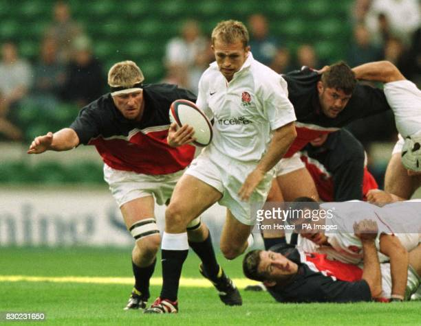 Matt Dawson of England breaks away from the tackle of USA player Luke Gross during their rugby union International friendly match at Twickenham