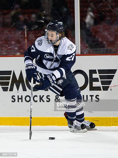 """Matt Dawson of the New Hampshire Wildcats skates against the Northeastern Huskies during NCAA hockey at Fenway Park during """"Frozen Fenway"""" on January..."""