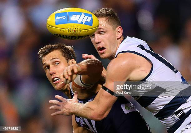 Matt De Boer of the Dockers and Joel Selwood of the Cats contest for the ball during the round nine AFL match between the Fremantle Dockers and the...