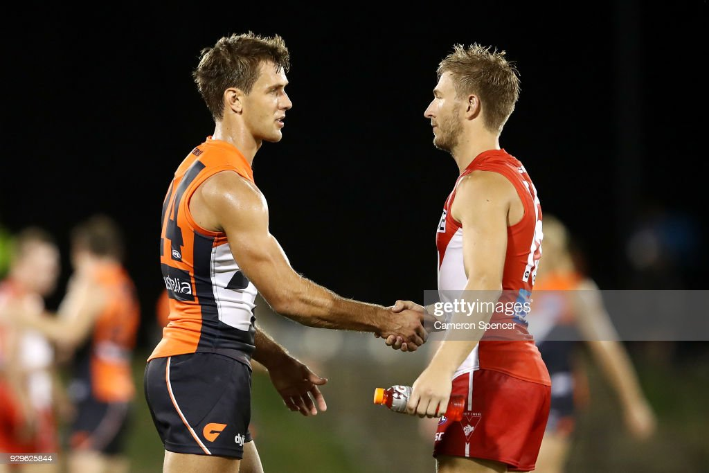 Matt de Boer of the Giants and Kieren Jack of the Swans shake hands following the JLT Community Series AFL match between the Sydney Swans and the Greater Western Sydney Giants at Blacktown International Sportspark on March 9, 2018 in Sydney, Australia.