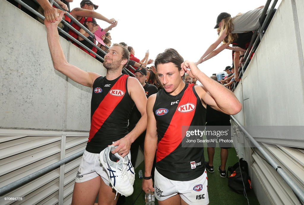 Matt Dea of the Bombers and Kyle Langford of the Bombers during the 2018 AFL round 12 match between the Brisbane Lions and the Essendon Bombers at The Gabba on June 10, 2018 in Brisbane, Australia.