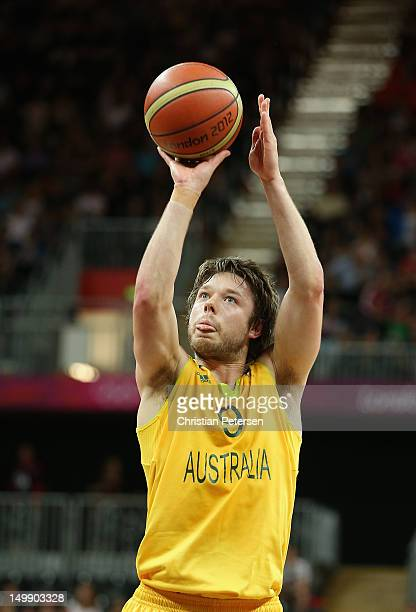 Matt Dellavedova of Australia shoots a free throw shot against Russia during the Men's Basketball Preliminary Round match on Day 10 of the London...