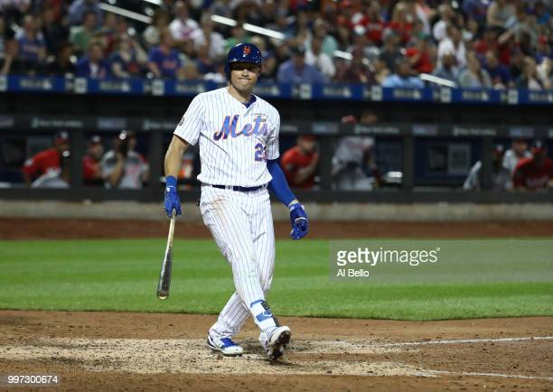 Matt Den Dekker of the New York Mets reacts after striking out with two men on base to end the eigth inning against the Washington Nationals during...