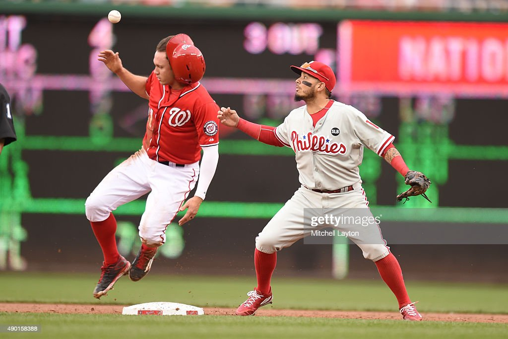 Matt den Dekker #21 of the Washington Nationals is forced out at second base by Freddy Galvis #13 of the Philadelphia Phillies on a Stephen Strasburg #37 (not pictured) fielders choice during a baseball game at Nationals Park on September 26, 2015 in Washington, DC.