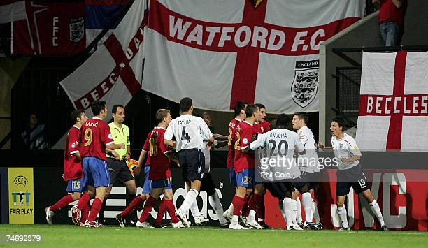 Matt Derbyshire of England celabrates scoring with the Serbia team chasing him during the UEFA European Under-21 Championships match between England...
