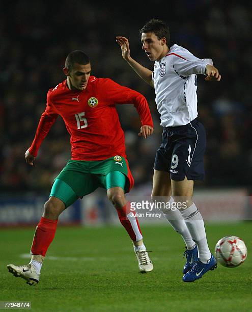 Matt Derbyshire of England is tackled by Dani Kiki of Bulgaria during the UEFA U21 Championship Qualifier Group Three match between England U21 and...