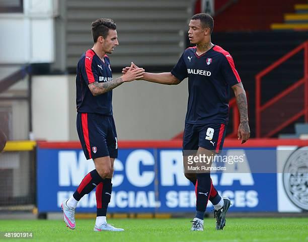 Matt Derbyshire of Rotherham celebrates scoring in the first half with team mate Jonson ClarkeHarris during a pre season friendly match between...