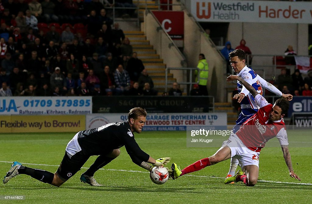 Matt Derbyshire of Rotherham scores the opening goal past goalkeeper Mikkel Andersen of Reading during the Sky Bet Championship match between Rotherham United and Reading at The New York Stadium on April 28, 2015 in Rotherham, England.