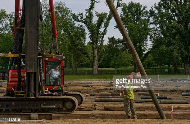 Matt Deshong and Juan Perez manuever a pole into place as the Lincoln Memorial Reflecting Pool Project continues in Washington DC on Monday May 10...